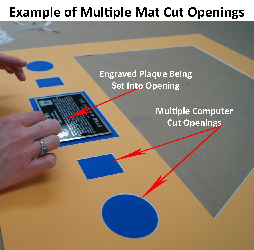 Example of Computer mat cut with a plaque being placed into one of the openings